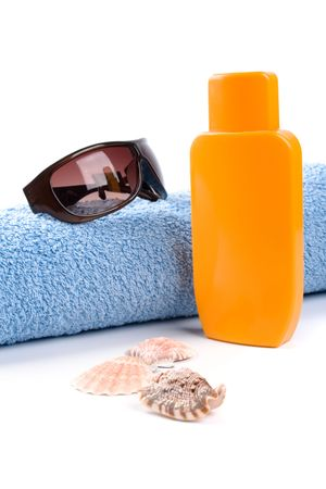 towel, sunglasses and lotion closeup on white background photo