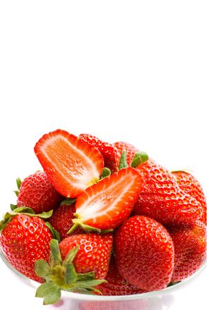 strawberries in the bowl closeup on white background photo