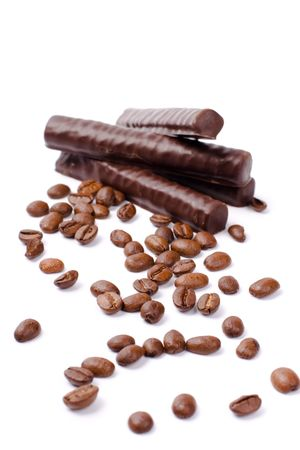 chocolate bars and coffee beans on white background photo