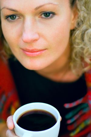beautiful woman holding a cup of hot drink Stock Photo - 4981876