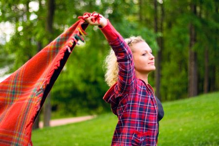 coverlet: pretty woman with red coverlet in the forest