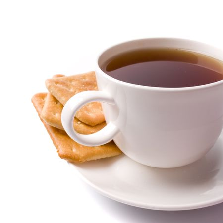 cup of tea and some cookies on white background photo