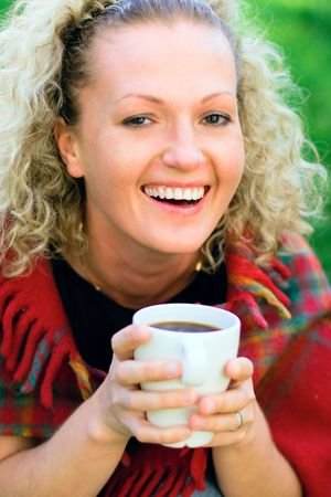 beautiful woman holding a cup of hot drink Stock Photo - 5023495