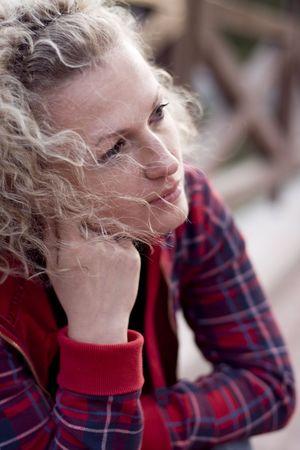 portrait of blond unhappy woman photo