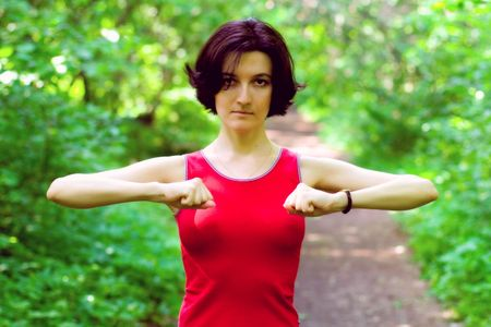 sporty woman working out on a forest . photo