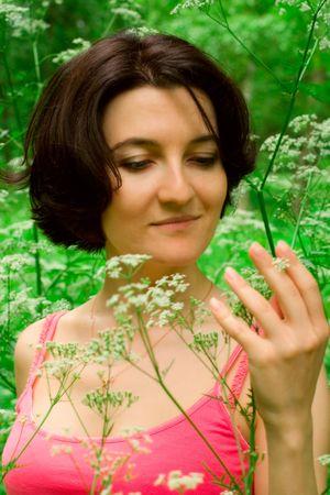 female relaxing in summer meadow photo