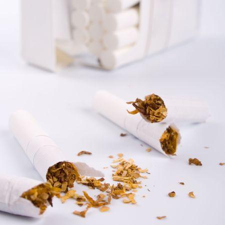 broken cigarettes on white background photo