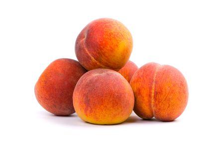 five peaches on white background photo