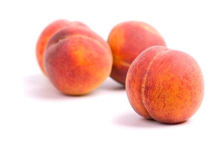 Vier perziken op witte achtergrond Stockfoto - 5152764
