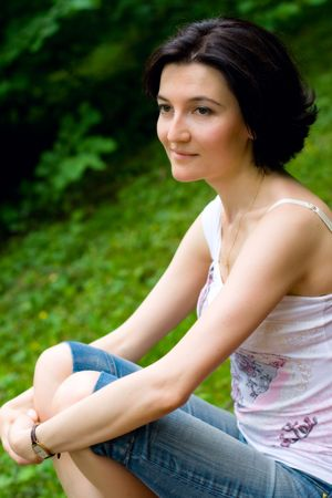 outdoor portrait of beautiful woman in the park photo