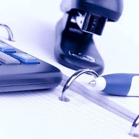 office item - business organizer, pen, calculator and stapler Stock Photo - 5415794