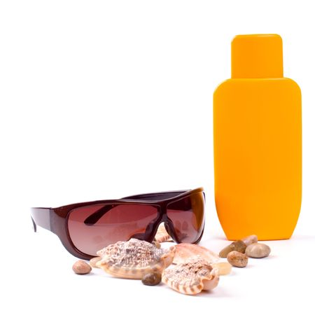 sunglasses and lotion closeup on white background photo