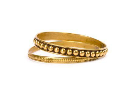 two golden bracelets isolated on white background photo