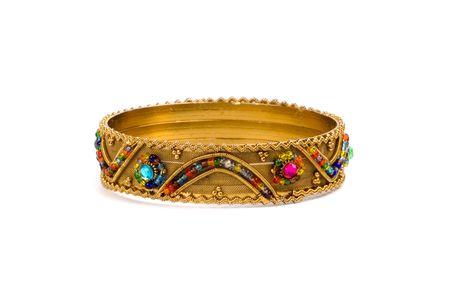 golden bracelet isolated on white background photo