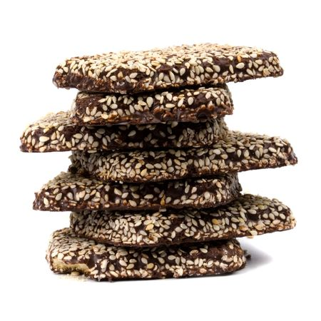 stack of chocolate coocies with sesame seeds isolated on white background photo