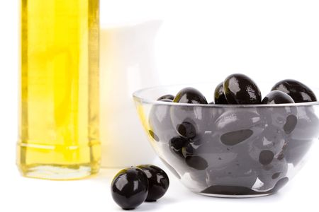 bowl of black olives and oil on white background photo