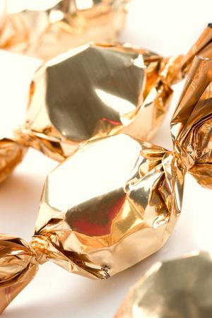 golden sweets closeup on white background photo