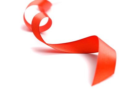 red satin ribbon closeup on white background photo