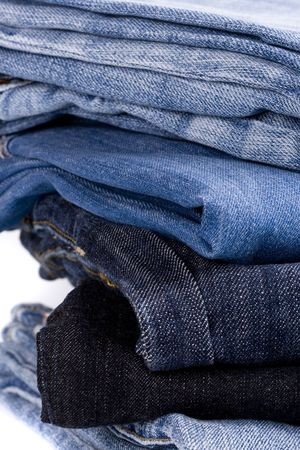stack of blue jeans closeup photo