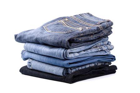 slacks: stack of blue jeans isolated on white background   Stock Photo