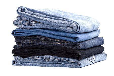 slacks: stack of blue jeans isolated on white background