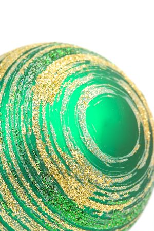 green glass christmas ball closeup on white background photo