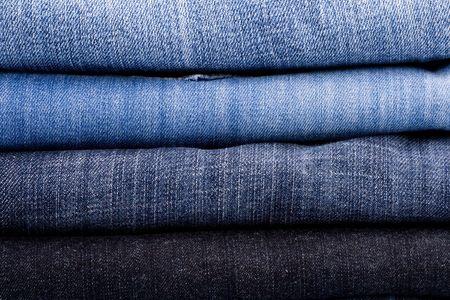 slacks: stack of blue jeans closeup