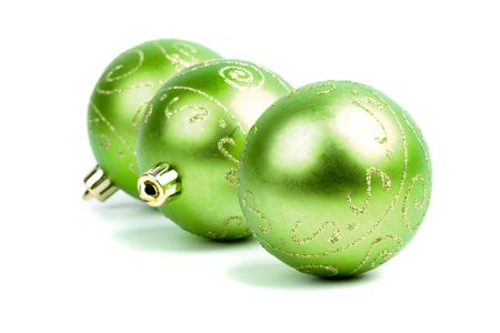 three green christmas balls isolated on white background photo