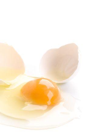 broken egg isolated on white background Stock Photo - 5871835