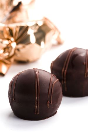 two opened foil chocolate candies closeup photo
