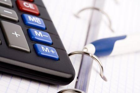 business organizer, pen and calculator  photo