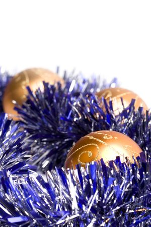 golden christmas balls and tinsel closeup photo