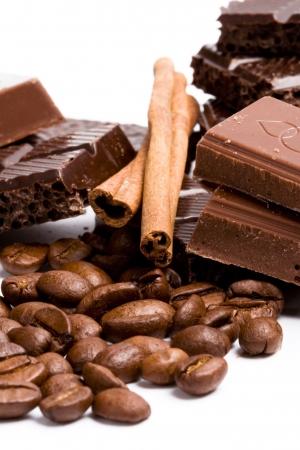 arrangement of chocolate, coffee and cinnamon sticks on white Stock Photo - 5936380