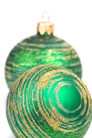 two green christmas balls isolated on white background photo