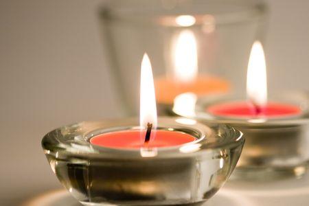 three candles flaming closeup photo