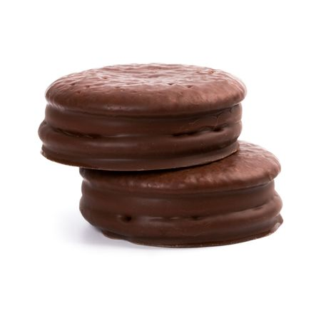 two chocolate cookies isolated on white background photo
