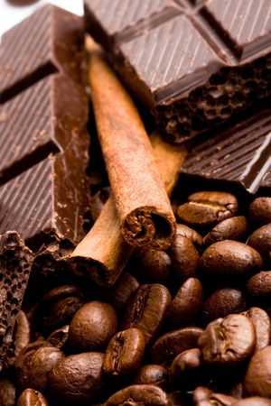 arrangement of chocolate, coffee and cinnamon sticks photo