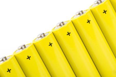 yellow alkaline batteries closeup on white backgroun photo