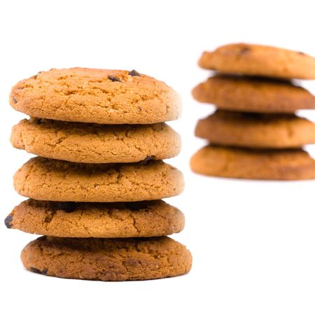 two stacks of oatmeal chocolate chip cookies isolated on white background photo