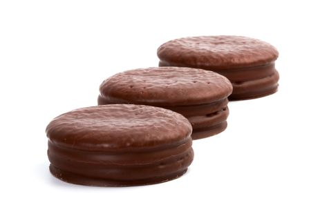 three chocolate cookies isolated on white background photo