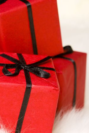 red gift boxes on white fur background photo