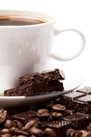 cup of coffee, beans and black chocolate closeup photo