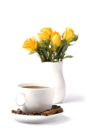 yellow flowers bouquet and cup of coffee on white background photo
