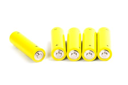 five yellow alkaline batteries isolated on white backgroun photo