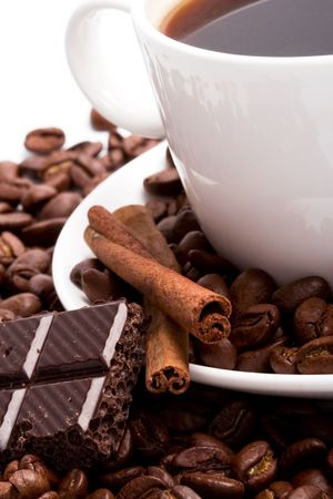 cup of coffee, beans, cinnamon and black chocolate closeup Stock Photo - 5991595