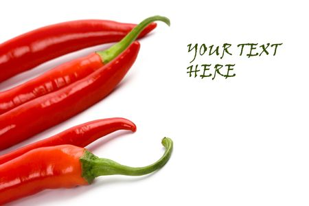 five red chilly peppers closeup on white background with sample text Stock Photo - 5991467