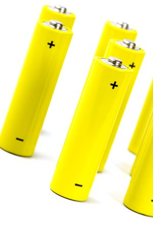 yellow alkaline batteries closeup on white background photo