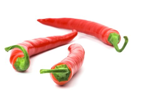 three red chilly peppers on white background Stock Photo - 5991766
