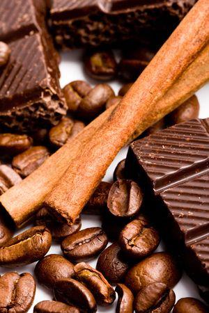 arrangement of chocolate, coffee and cinnamon sticks  closeup photo
