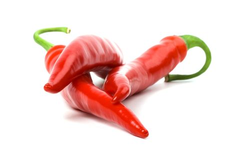 three red chilly peppers on white background photo